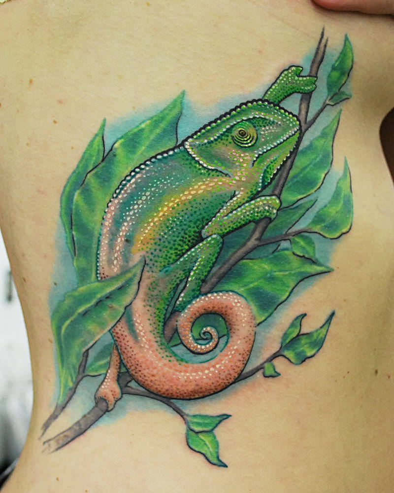 This-stylized-chameleon-tattoo-by-Josh-Hansen-shows-off-the-prehensile-tail-of-the-chameleon.jpg