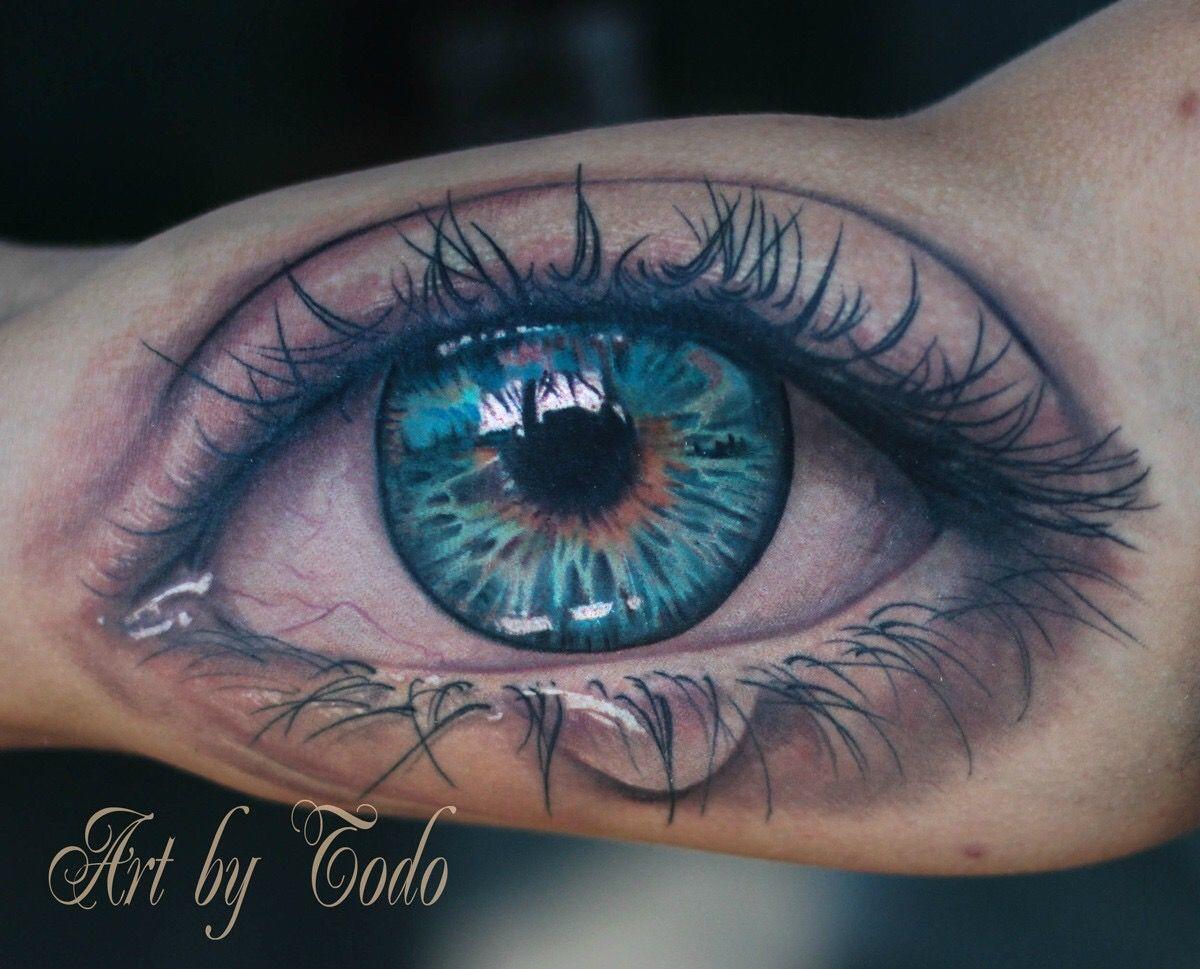 Что означает тату глаз в треугольнике